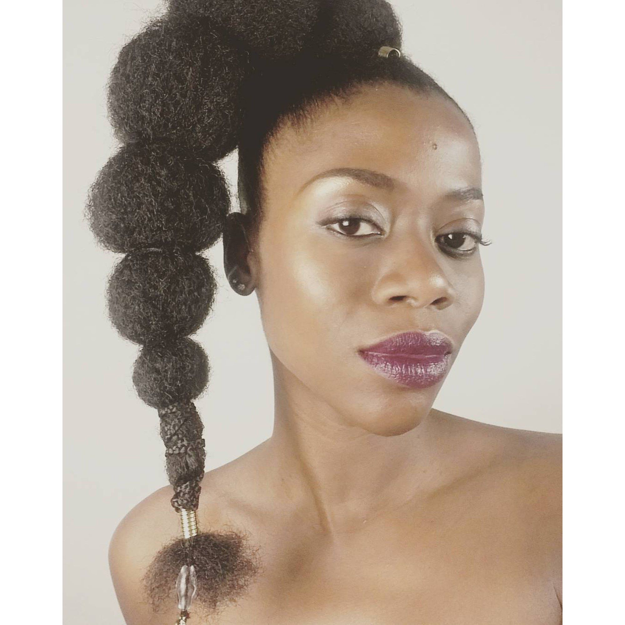 Afro Puff Bubble Ponytails Are Trending On Instagram Inside Famous Natural Bubble Ponytail Updo Hairstyles (Gallery 16 of 20)