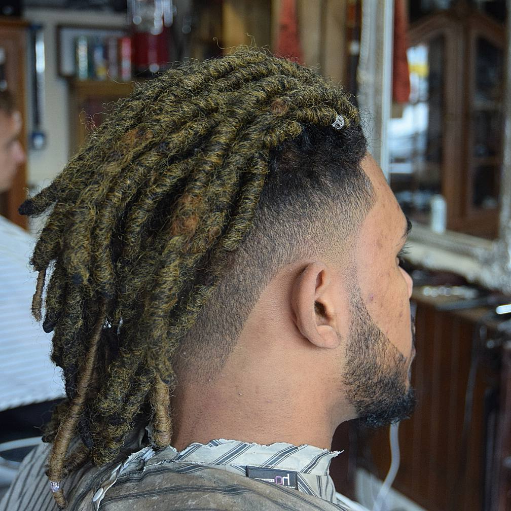 Dreadlock Styles For Men For Newest Tightly Coiled Gray Dreads Bun Hairstyles (View 8 of 20)