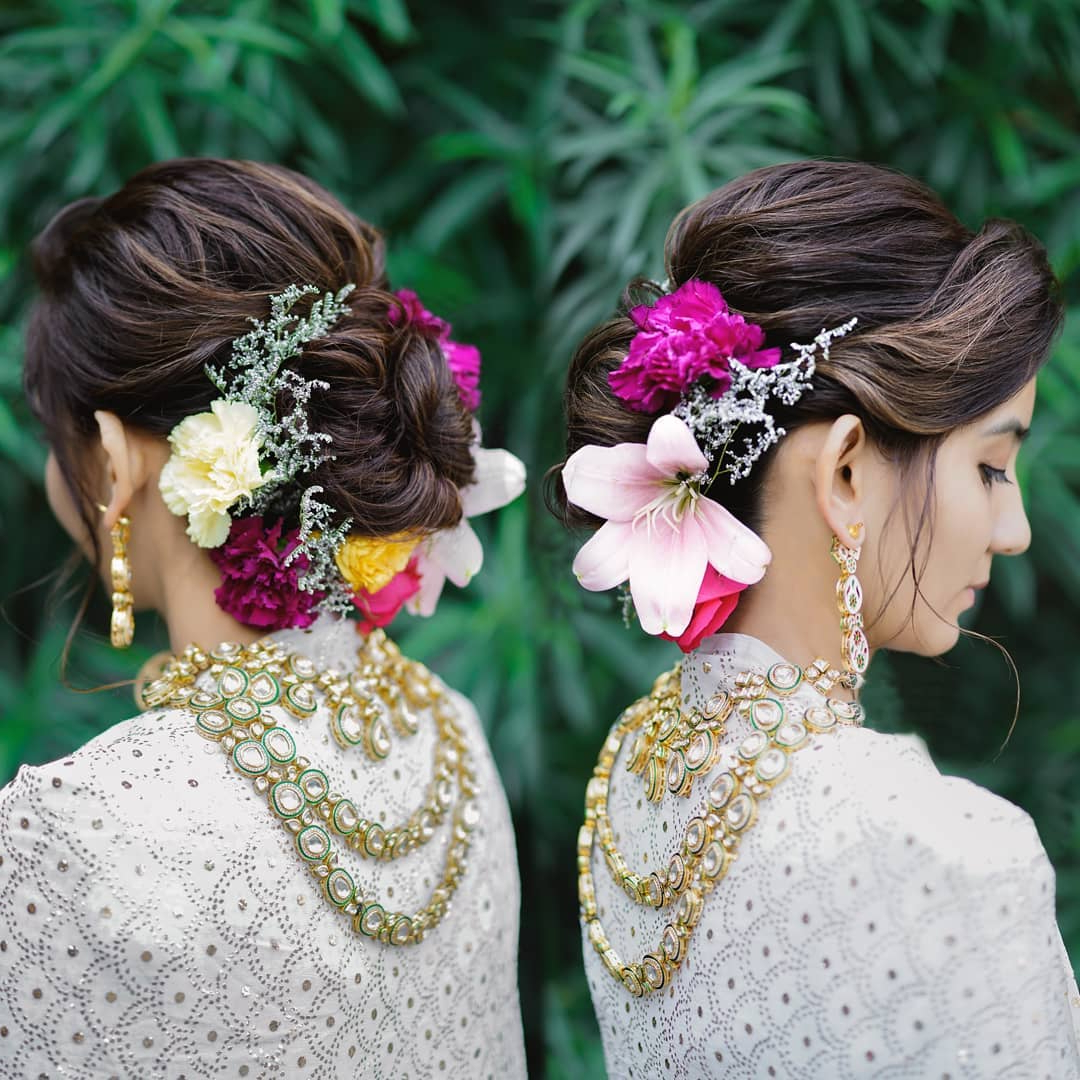 Fashionable Floral Bun Updo Hairstyles With Regard To Top Trend – Floral Hairstyles For Brides This Wedding Season! (View 4 of 20)