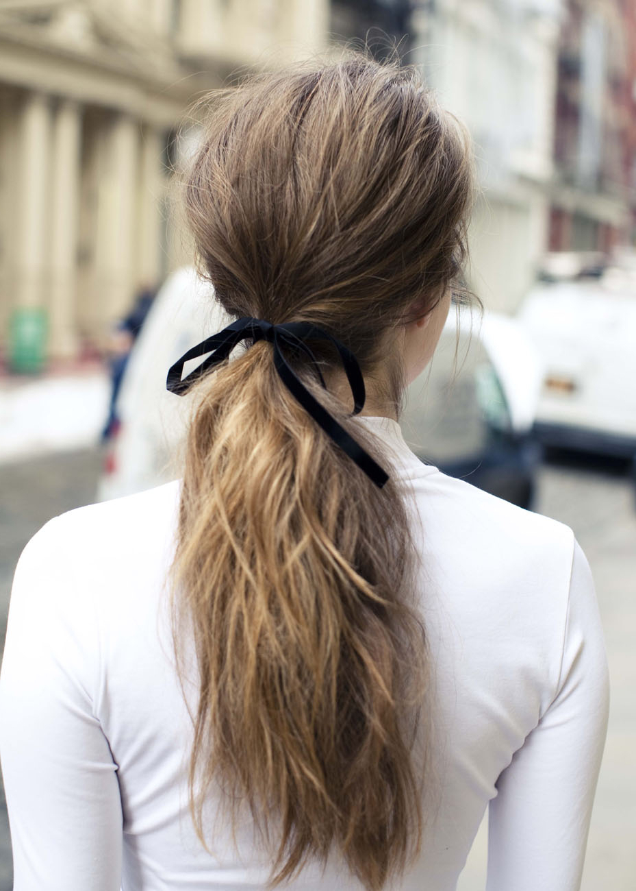 How To Make Even The Simplest Ponytail Pretty – Coveteur Inside Well Known Loosely Tied Braided Hairstyles With A Ribbon (View 14 of 20)