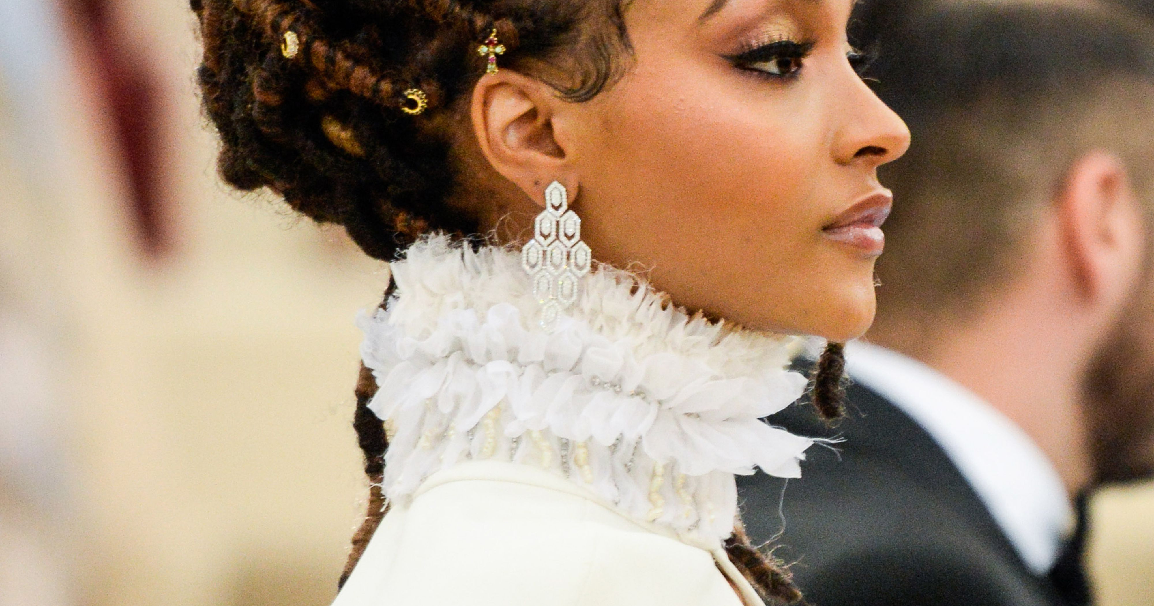Loc Updos, Braids, And Twists For Wedding Season Throughout Most Up To Date Side Swept Yarn Twists Hairstyles (View 15 of 20)