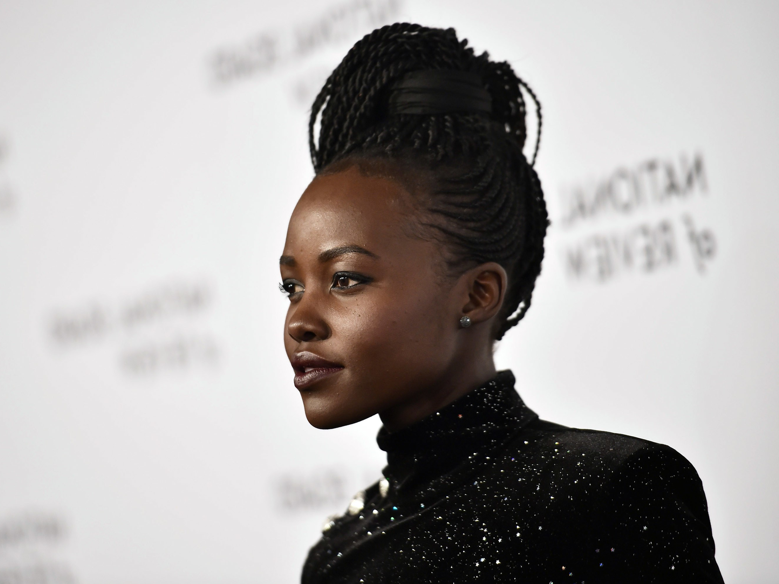Lupita Nyong'o Steps Out In Gorgeous Senegalese Twist Regarding Best And Newest Side Parted Micro Twist Hairstyles (View 13 of 20)