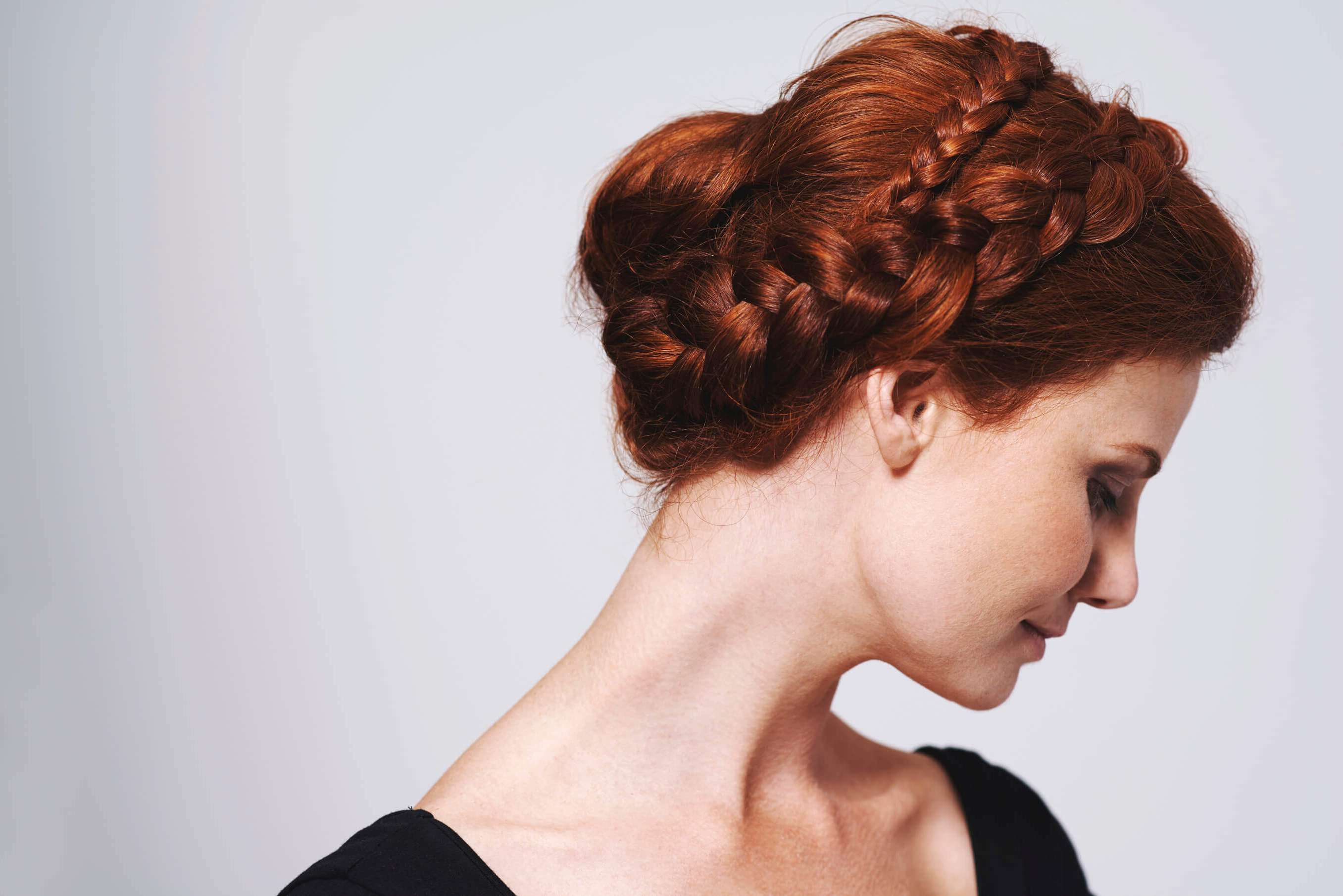 Most Current Messy Bun Hairstyles With Double Headband In Braided Updo: 12 Trendy Hairstyles To Try For Work (View 14 of 20)