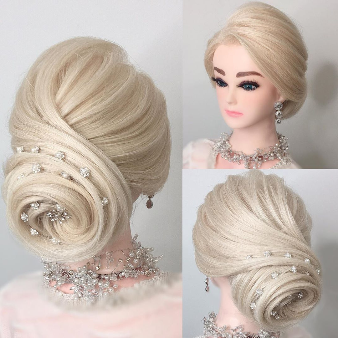 Most Popular Swirl Bun Updo Hairstyles Intended For Texture Swirl Updo #updo #weddinghair #bridalhair #bridal (View 9 of 20)