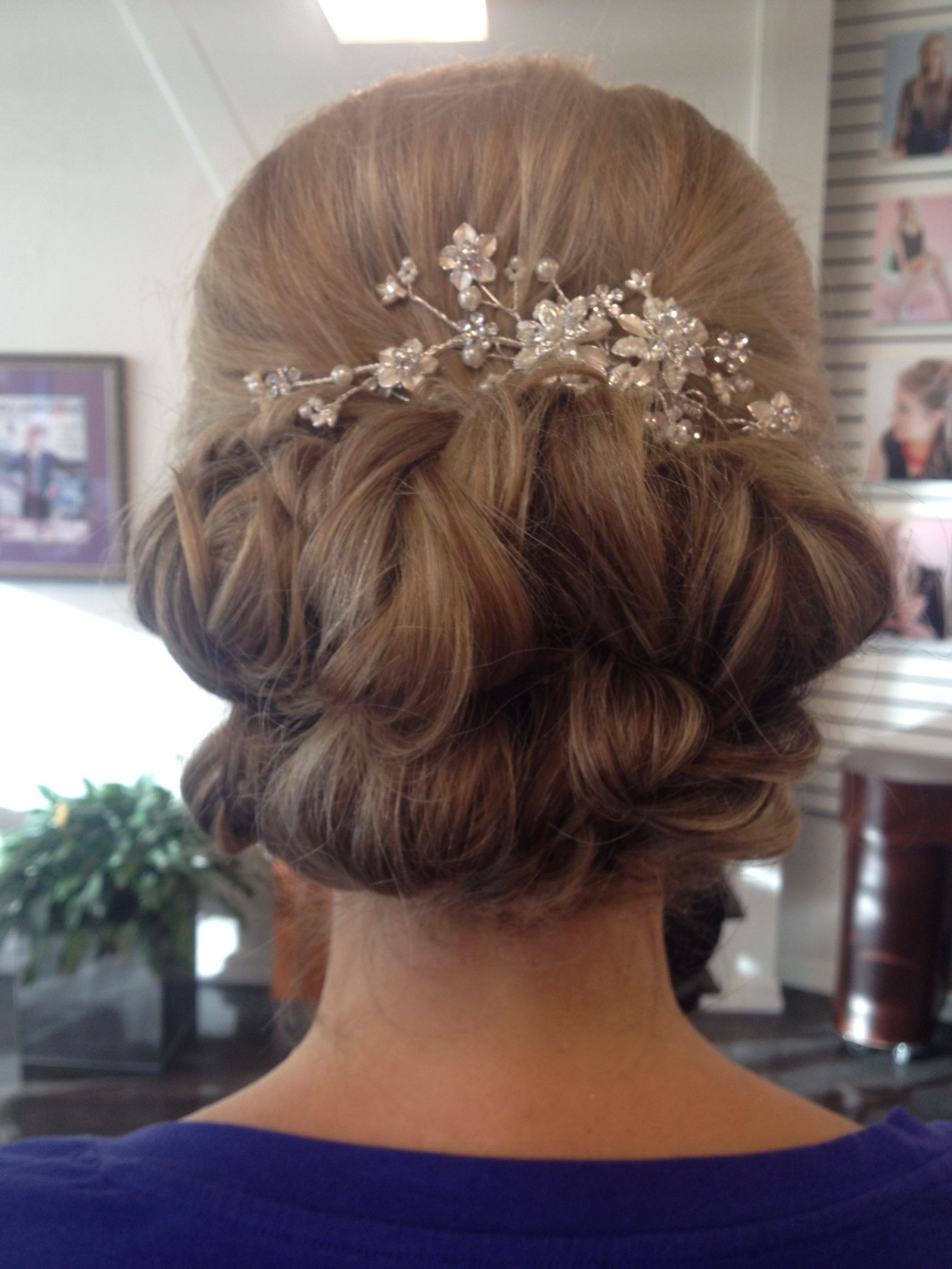 Most Recent High Volume Donut Bun Updo Hairstyles Throughout Low Curled Updo With High Volume And Decorative Hair Piece (View 11 of 20)