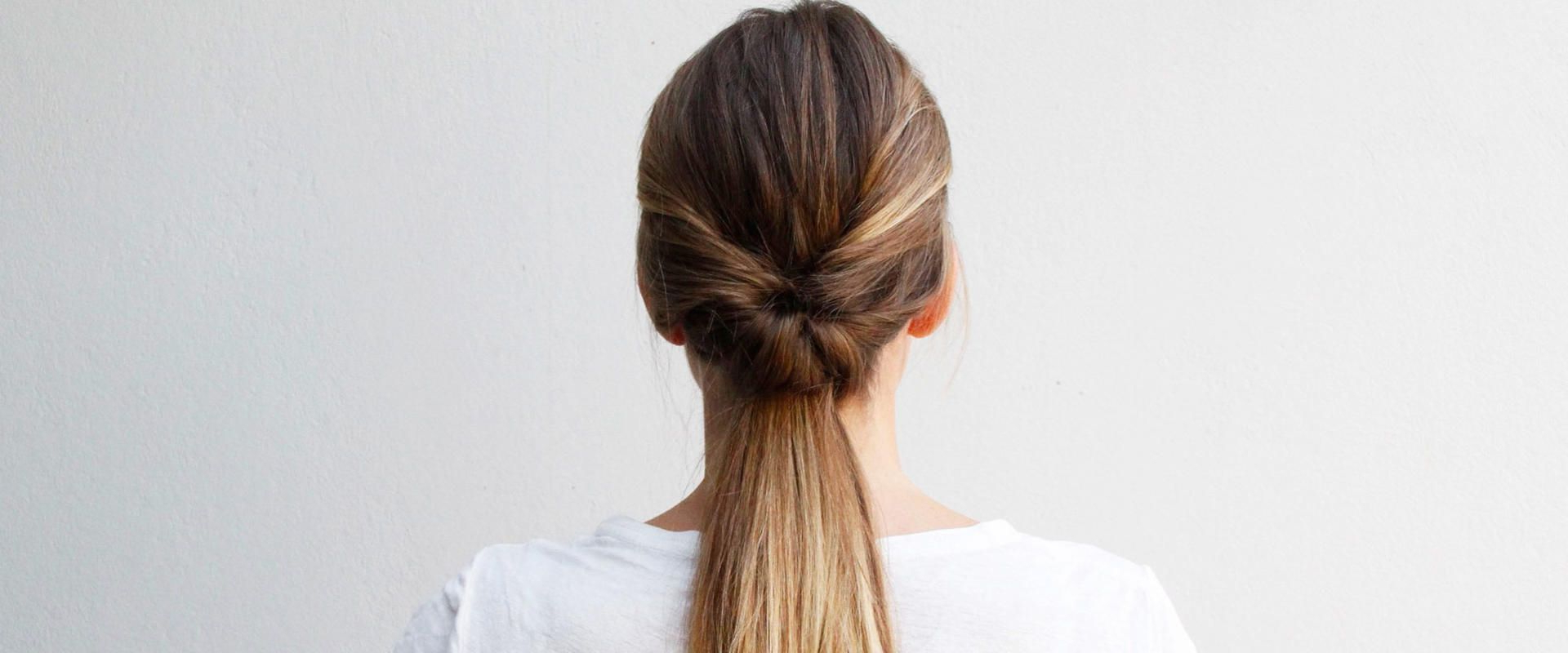 Most Recently Released Double Twist Bun Updo Hairstyles With Regard To This Double Twist Ponytail Is The Perfect Five Minute (View 13 of 20)
