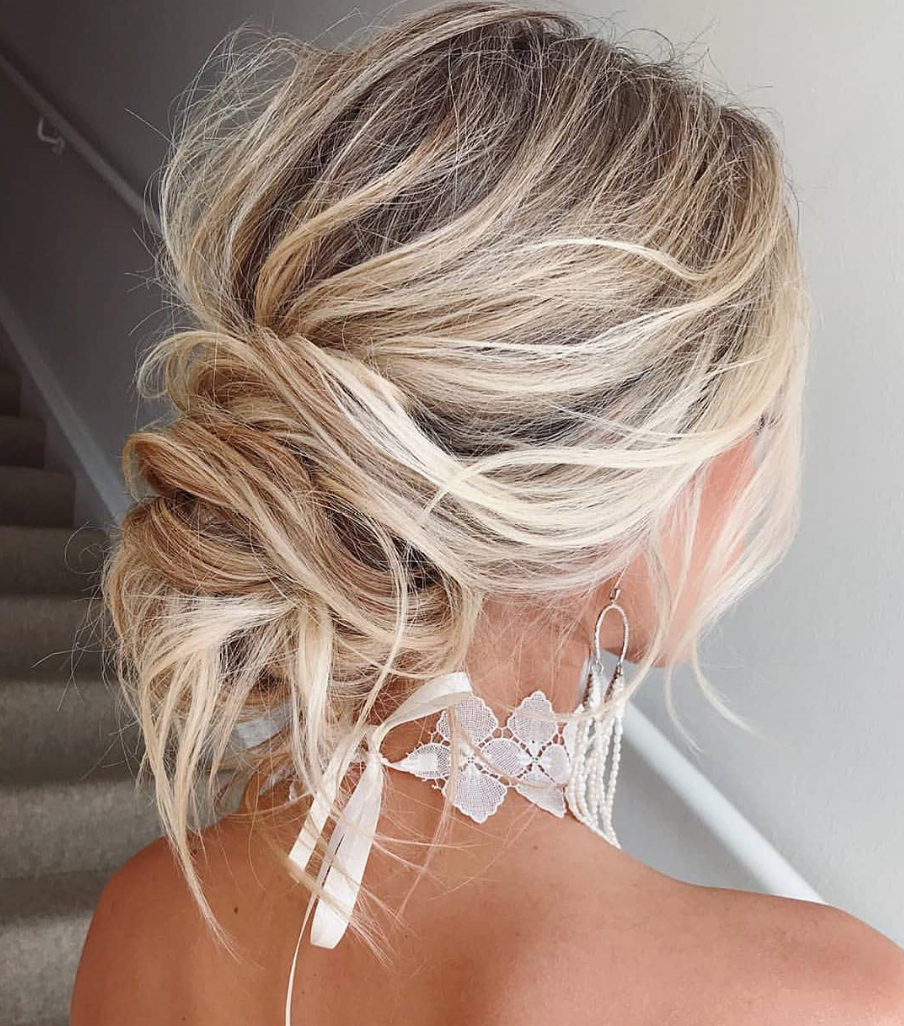 Trending Now: Boho Chic Messy Bun Wedding Hairstyles – Green Intended For Recent Messy Bun Hairstyles (View 18 of 20)