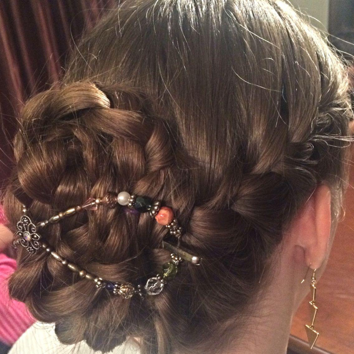 Well Liked Secured Wrapping Braided Hairstyles With Regard To French Braided Pigtails, One Wrapped Into A Bun Shape And (View 17 of 20)