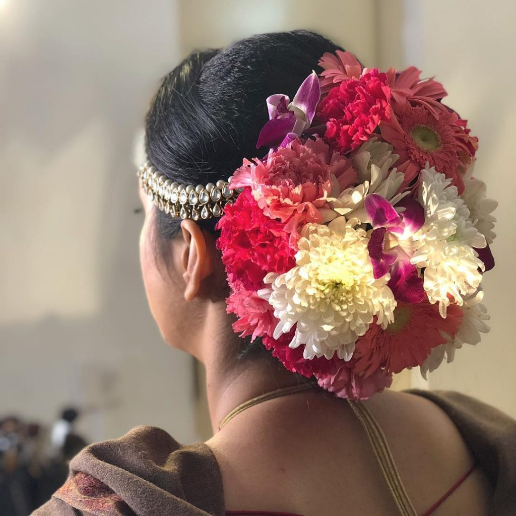 Widely Used Floral Bun Updo Hairstyles Throughout Top Trend – Floral Hairstyles For Brides This Wedding Season! (View 13 of 20)
