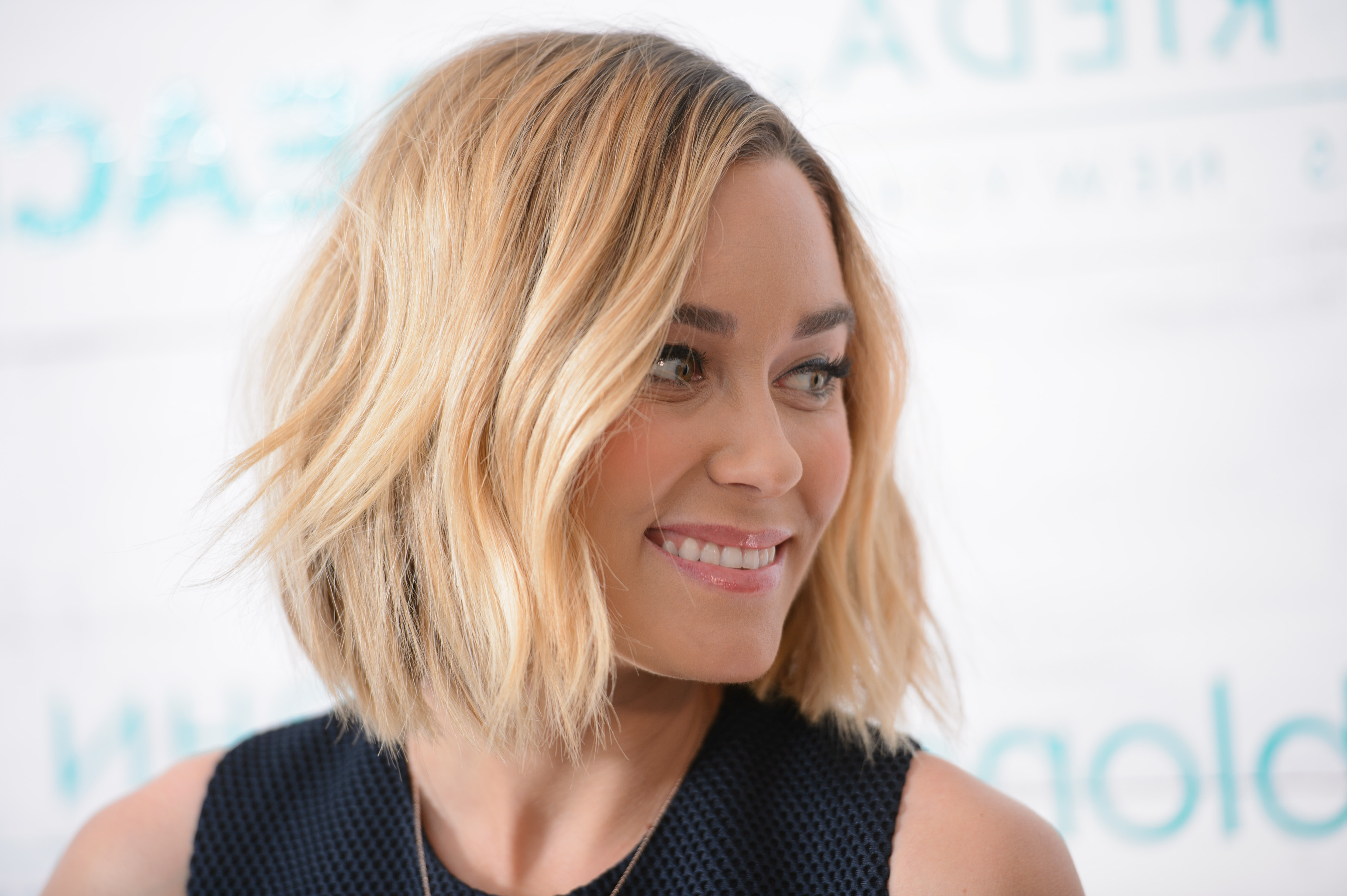 30 Short Wavy Hairstyles For Bouncy Textured Looks Intended For Widely Used Cascading Silky Waves Hairstyles (View 17 of 20)