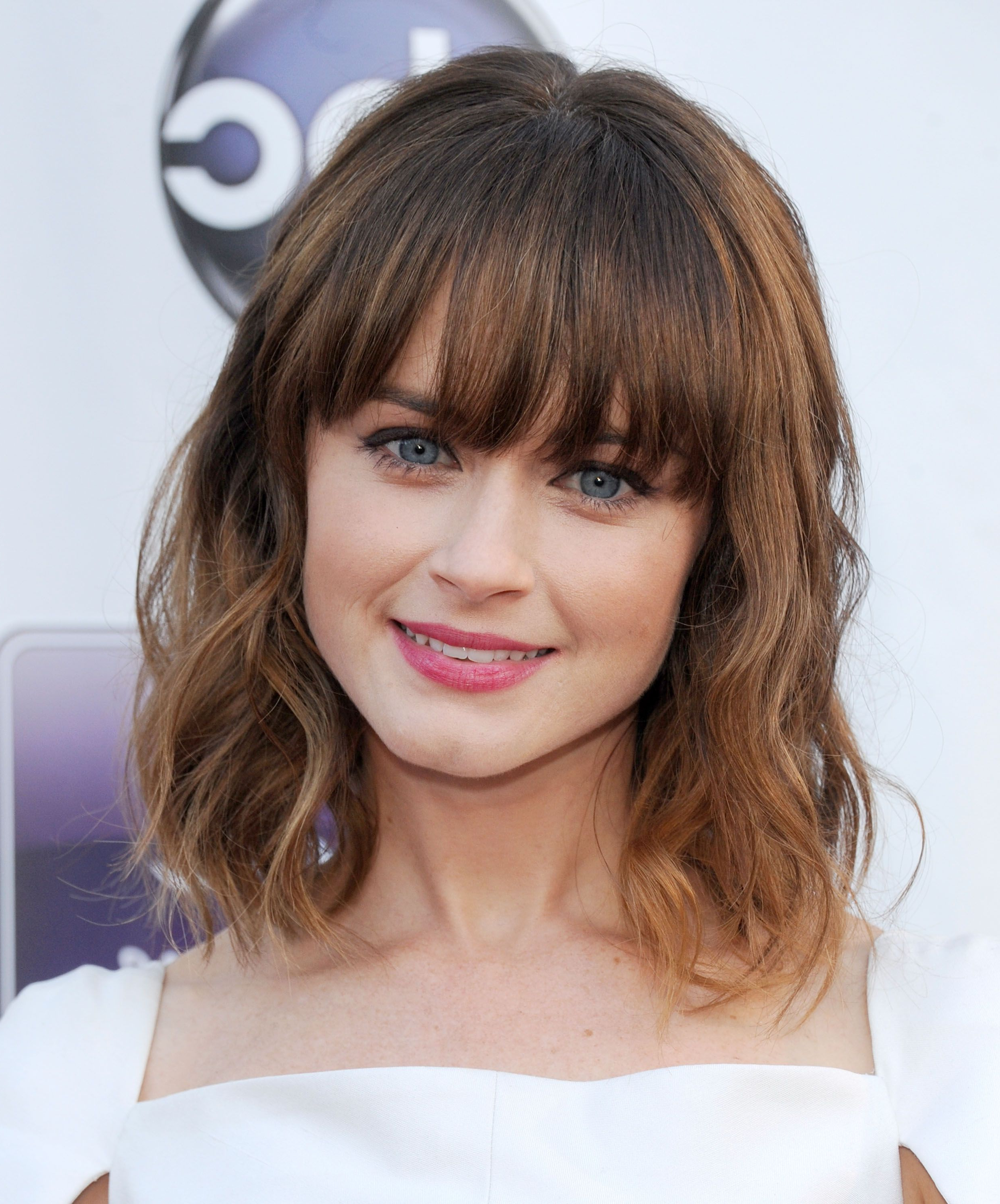 35 Best Hairstyles With Bangs – Photos Of Celebrity Haircuts Throughout Well Known Soft And Casual Curls Hairstyles With Front Fringes (View 2 of 20)