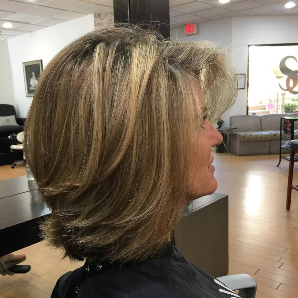 51 Stunning Medium Length Layered Haircuts & Hairstyles For 2019 Inside Well Known Layered And Outward Feathered Bob Hairstyles With Bangs (View 3 of 20)