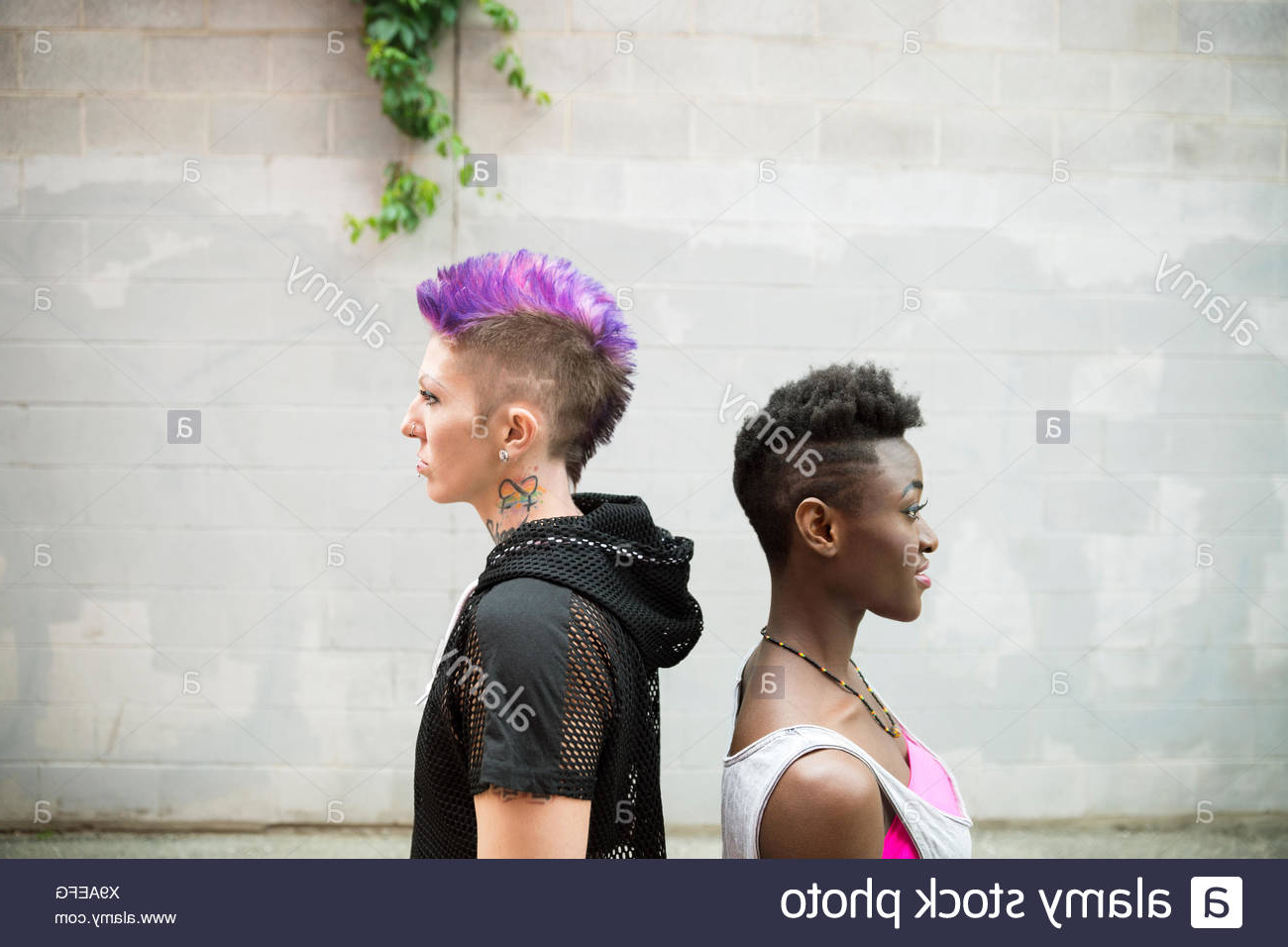 Cool Young Women With Shaved Head And Purple Mohawk Back To In 2020 Icy Purple Mohawk Hairstyles With Shaved Sides (View 12 of 20)