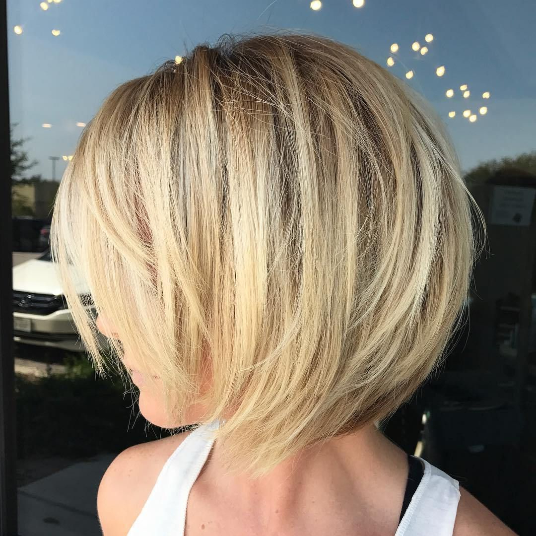 Most Current Layered And Outward Feathered Bob Hairstyles With Bangs With Pin On Hair (View 11 of 20)