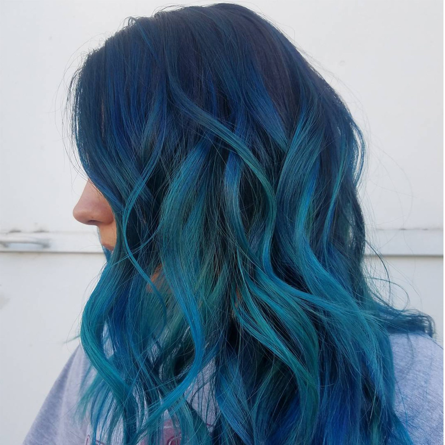 Ocean Blue Hair Colors Are Making Waves On Instagram This For Famous Black And Denim Blue Waves Hairstyles (View 13 of 20)