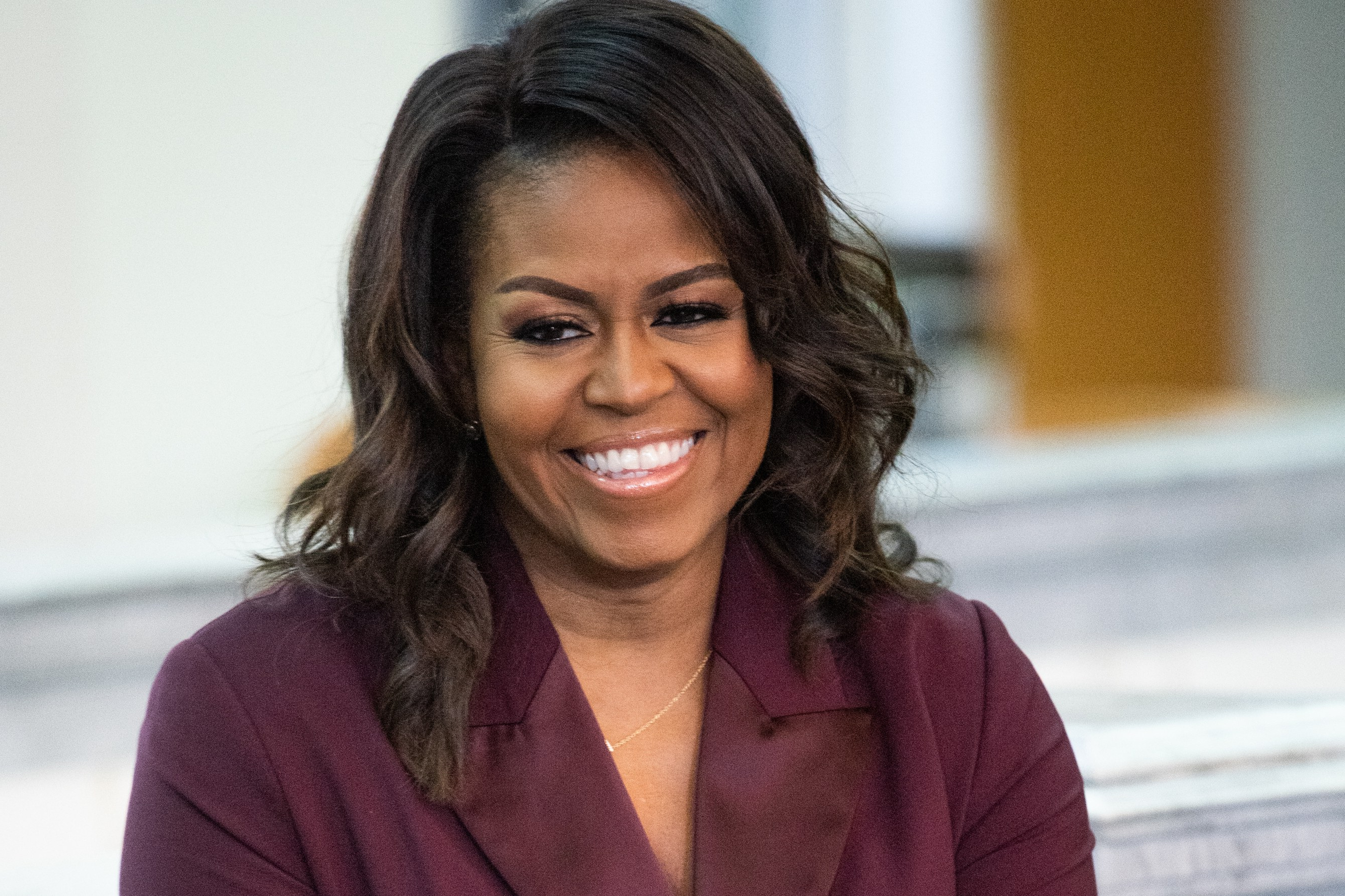 Michelle Obama Gave Her Natural Curls Blonde Ombré Regarding Curls And Blonde Highlights Hairstyles (View 17 of 20)