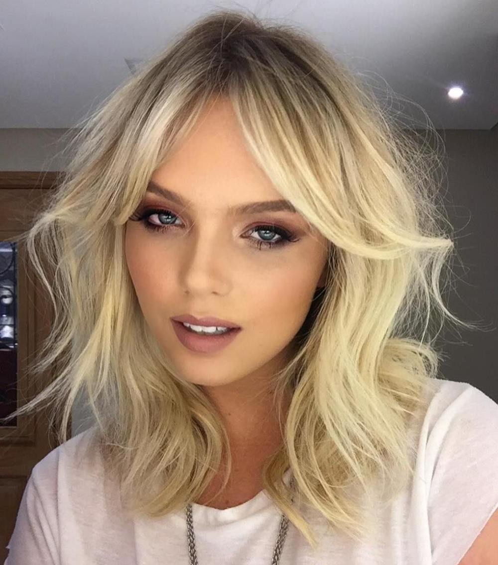 20 Best Hairstyles For Big Foreheads To Enhance Your Inside Recent Wispy Layered Blonde Haircuts With Bangs (View 1 of 20)