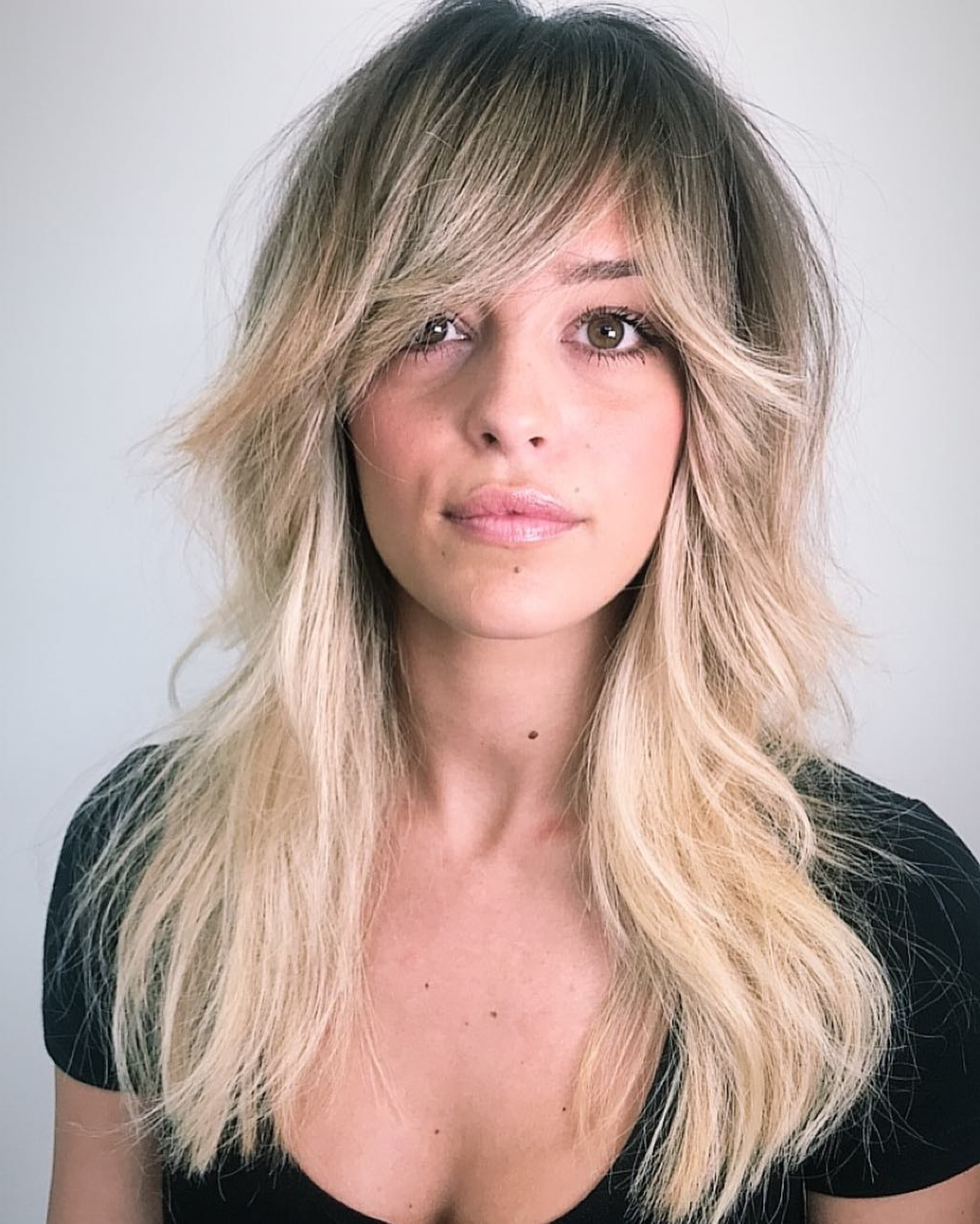 2019 Long Hairstyles With Short Flipped Up Layers Regarding The Most Instagrammable Hairstyles With Bangs In (View 16 of 20)