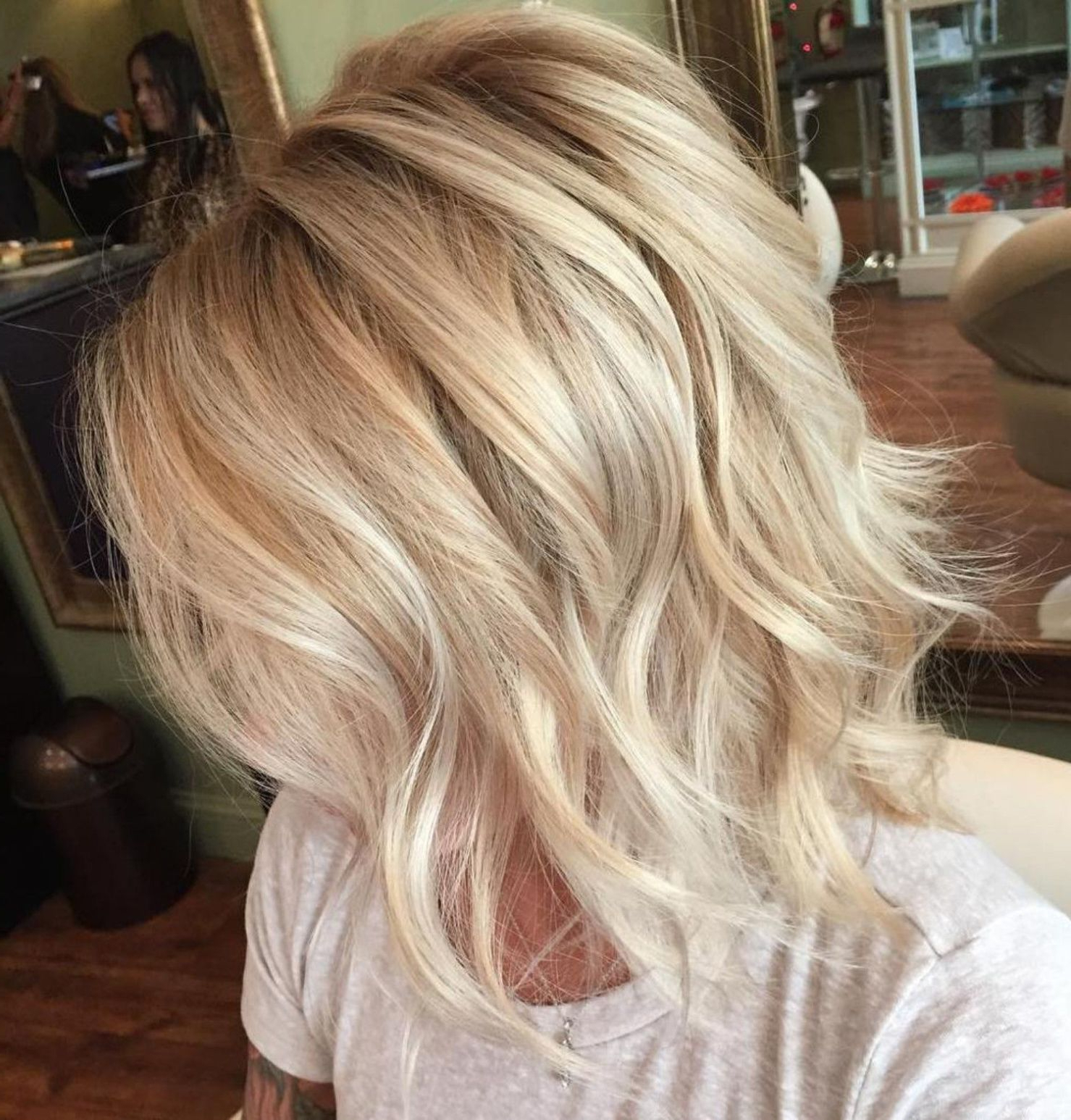 2019 Pretty Wavy Blonde Shag Haircuts With Pin On Hair (View 13 of 20)