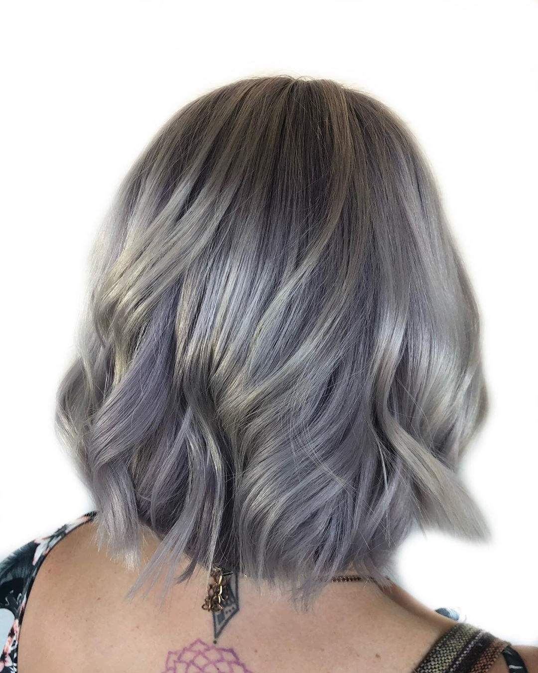 40+ Silver Hair Color Ideas & 2019 Trends: Highlights In Dusty Lavender Short Shag Haircuts (View 11 of 20)