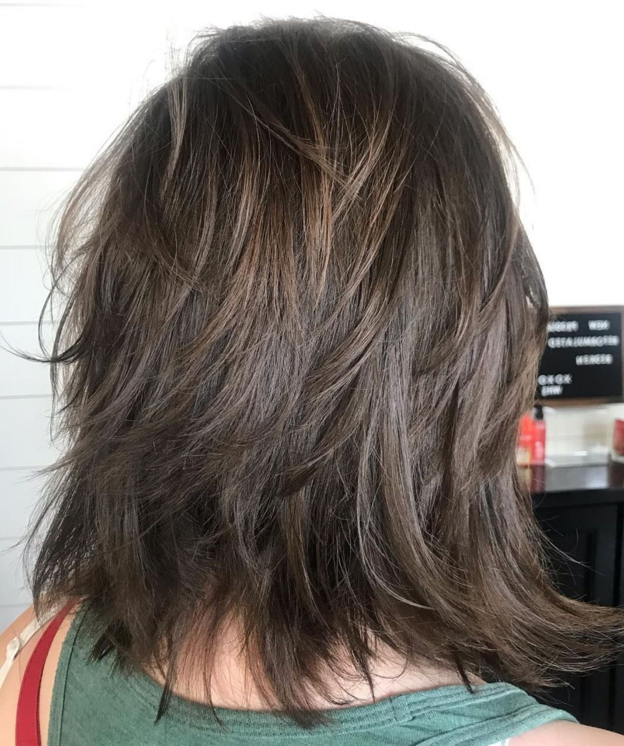 Featured Photo of Dynamic Feathered Brunette Shag Haircuts