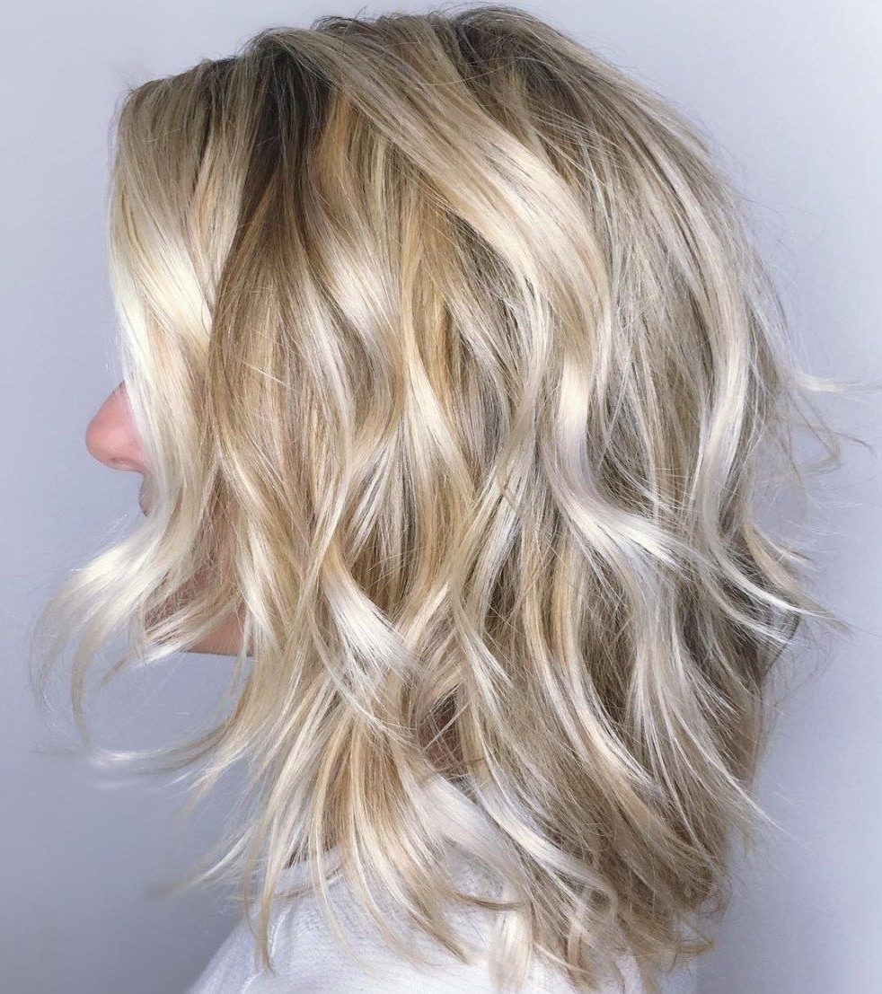 Featured Photo of Delicate Light Blonde Shag Haircuts