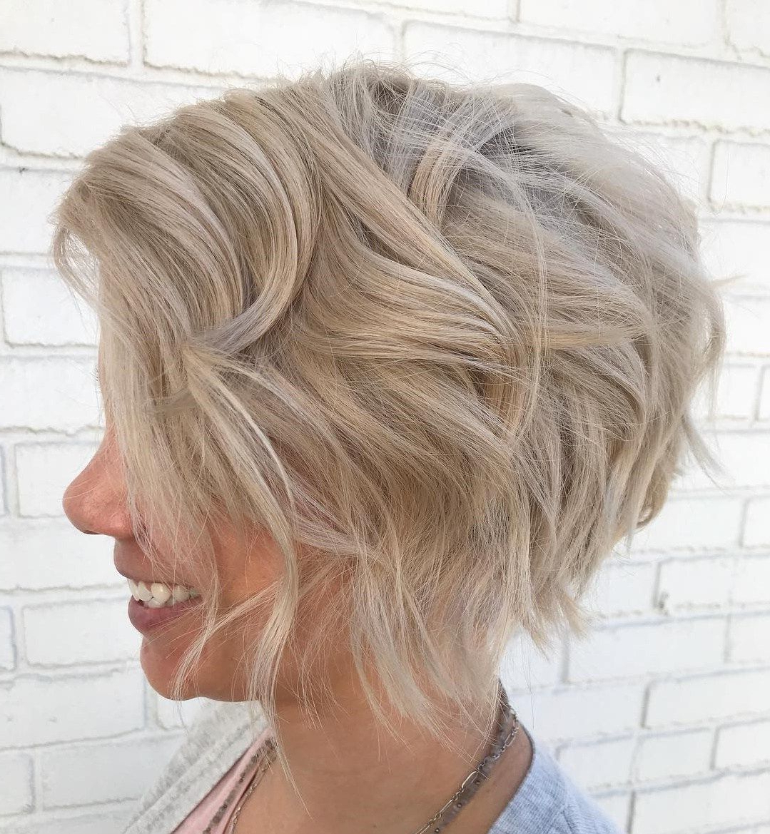 Featured Photo of Sophisticated Wavy Ash Blonde Pixie Bob Hairstyles