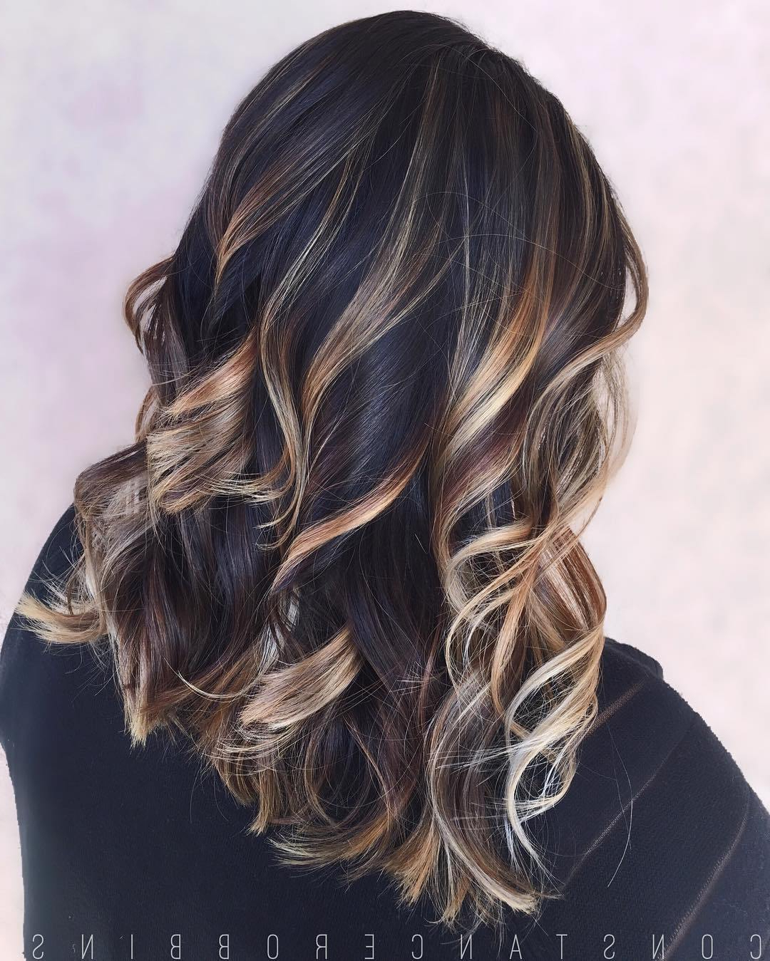 Black Hair With Blonde Highlights For 2020 Intended For Recent Shiny Black Haircuts With Flicked Layers (View 14 of 20)