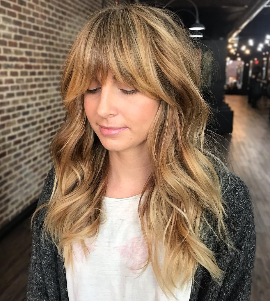 Bombshell Long Hairstyles For Women To Keep Up With Trends Inside Recent Blue Black Shag Haircuts With Arched Bangs (View 12 of 20)
