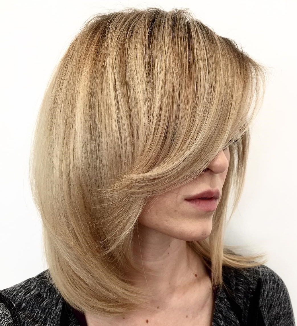 Bombshell Long Hairstyles For Women To Keep Up With Trends Intended For Widely Used Blondie Bombshell Long Shag Hairstyles (View 9 of 20)