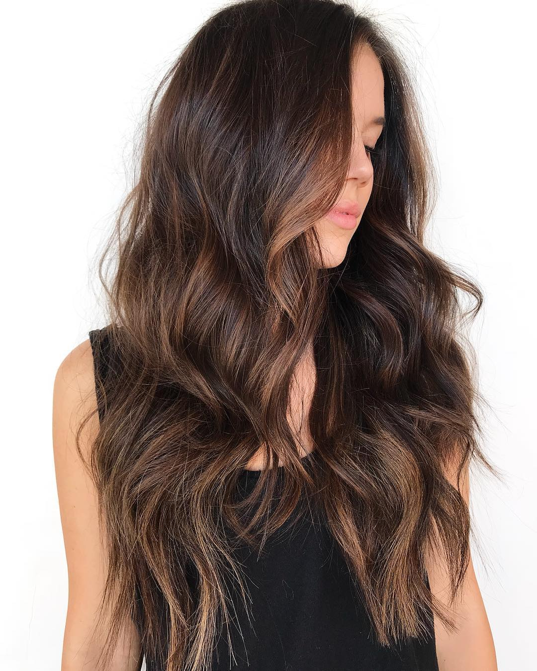 Current Shiny Brunette Shag Haircuts For Long Hair Throughout The Most Instagrammable Hairstyles With Bangs In (View 10 of 20)
