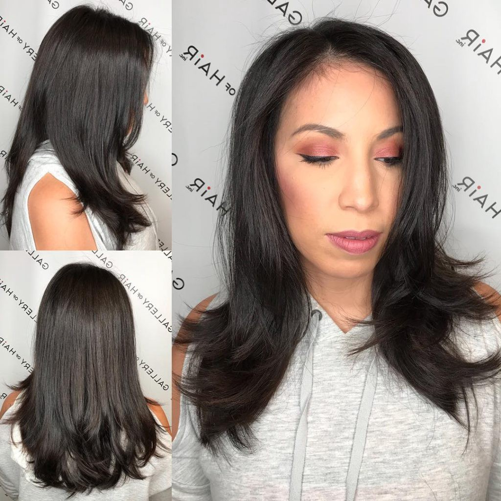 Dark Brunette Layered Cut With Soft Blowout Waves And Face Pertaining To Recent Face Framing Wavy Hairstyles (View 9 of 20)