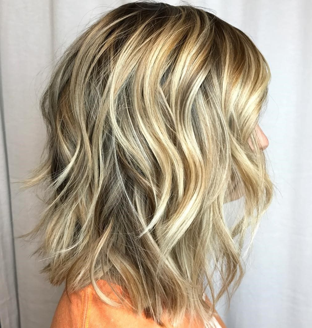 Featured Photo of Pretty Wavy Blonde Shag Haircuts