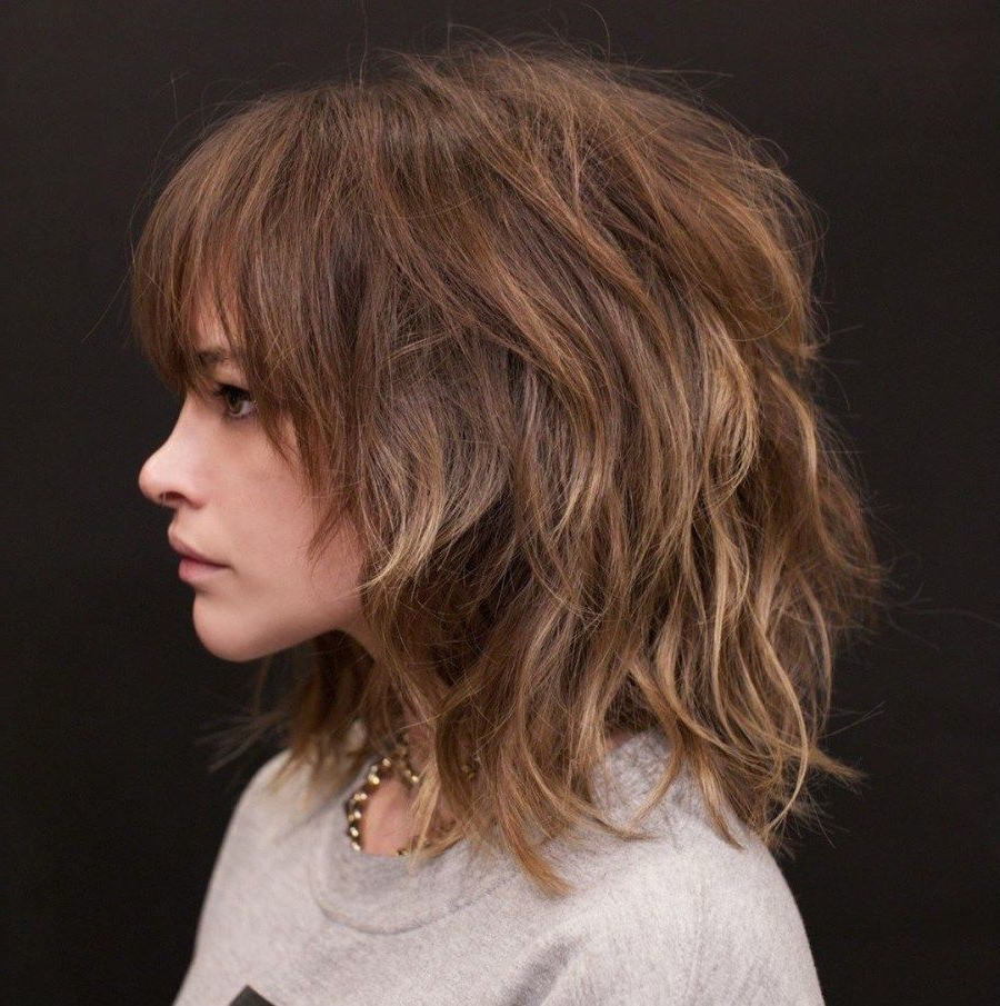 Featured Photo of Medium Messy Shag Haircuts With Arched Bangs