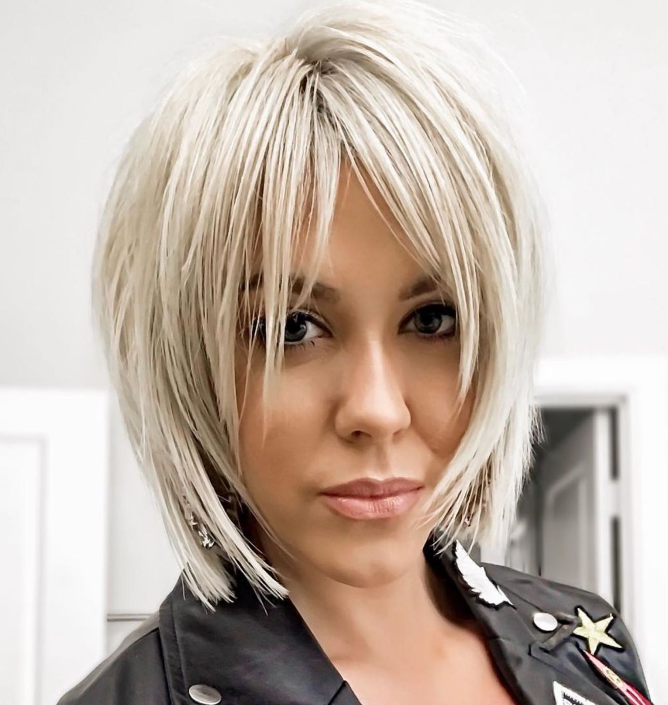 Featured Photo of Sliced Platinum Blonde Bob Hairstyles