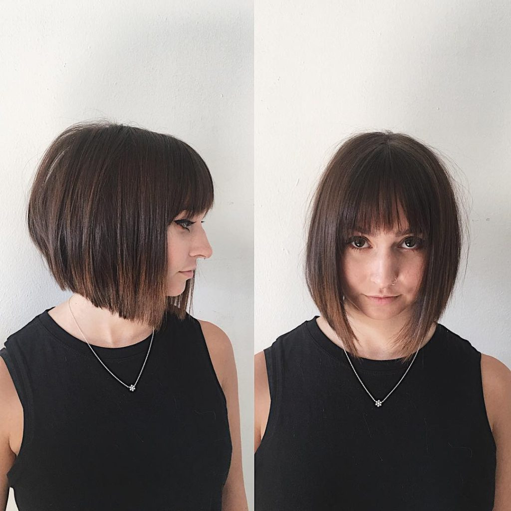 Latest Shag Haircuts With Blunt Ends And Angled Layers Pertaining To Women's Chic Blunt Angled Bob With Feathered Bangs And (View 12 of 20)