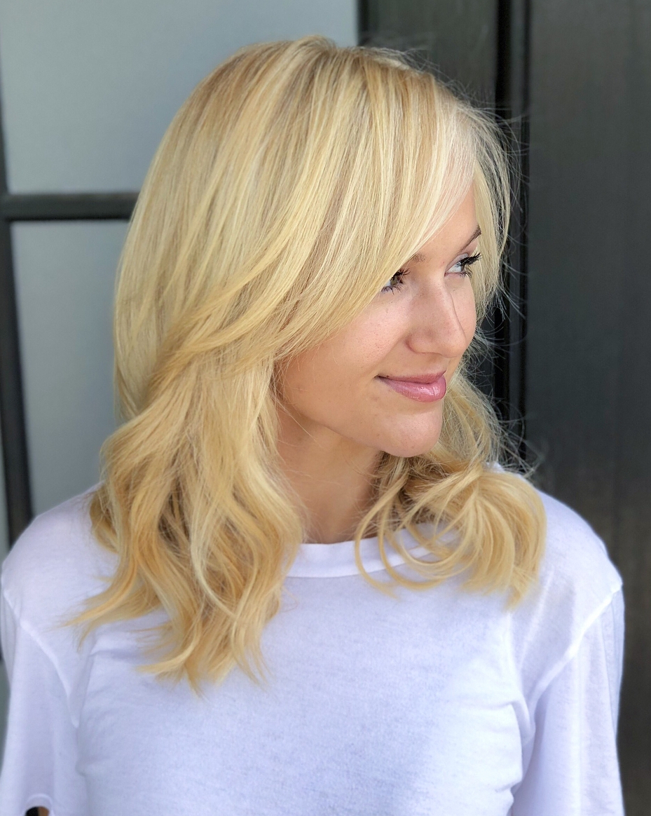 Latest Wispy Layered Blonde Haircuts With Bangs For The Most Instagrammable Hairstyles With Bangs In (View 12 of 20)