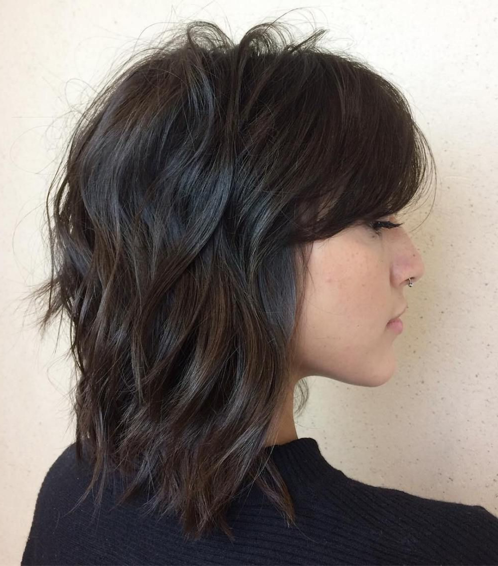 Featured Photo of Brunette Wavy Razored Shag Haircuts