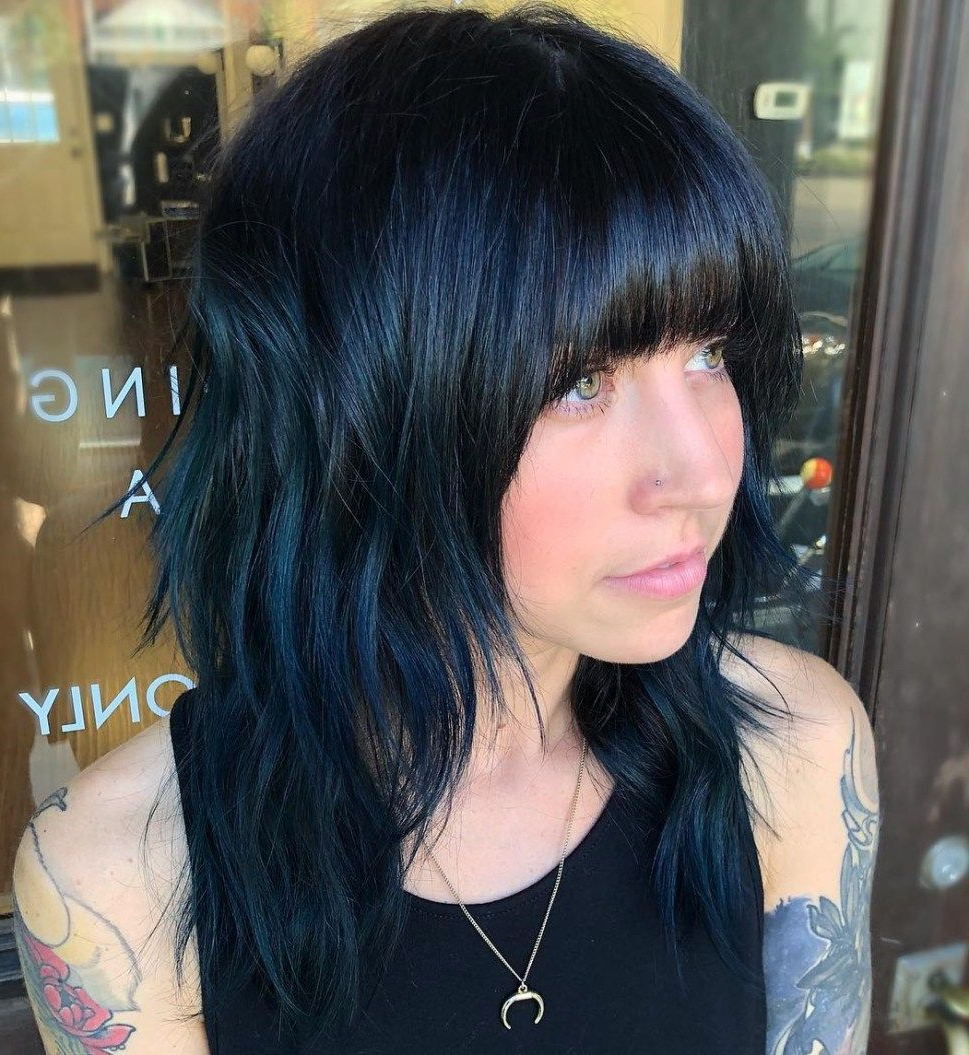 Featured Photo of Blue Black Shag Haircuts With Arched Bangs