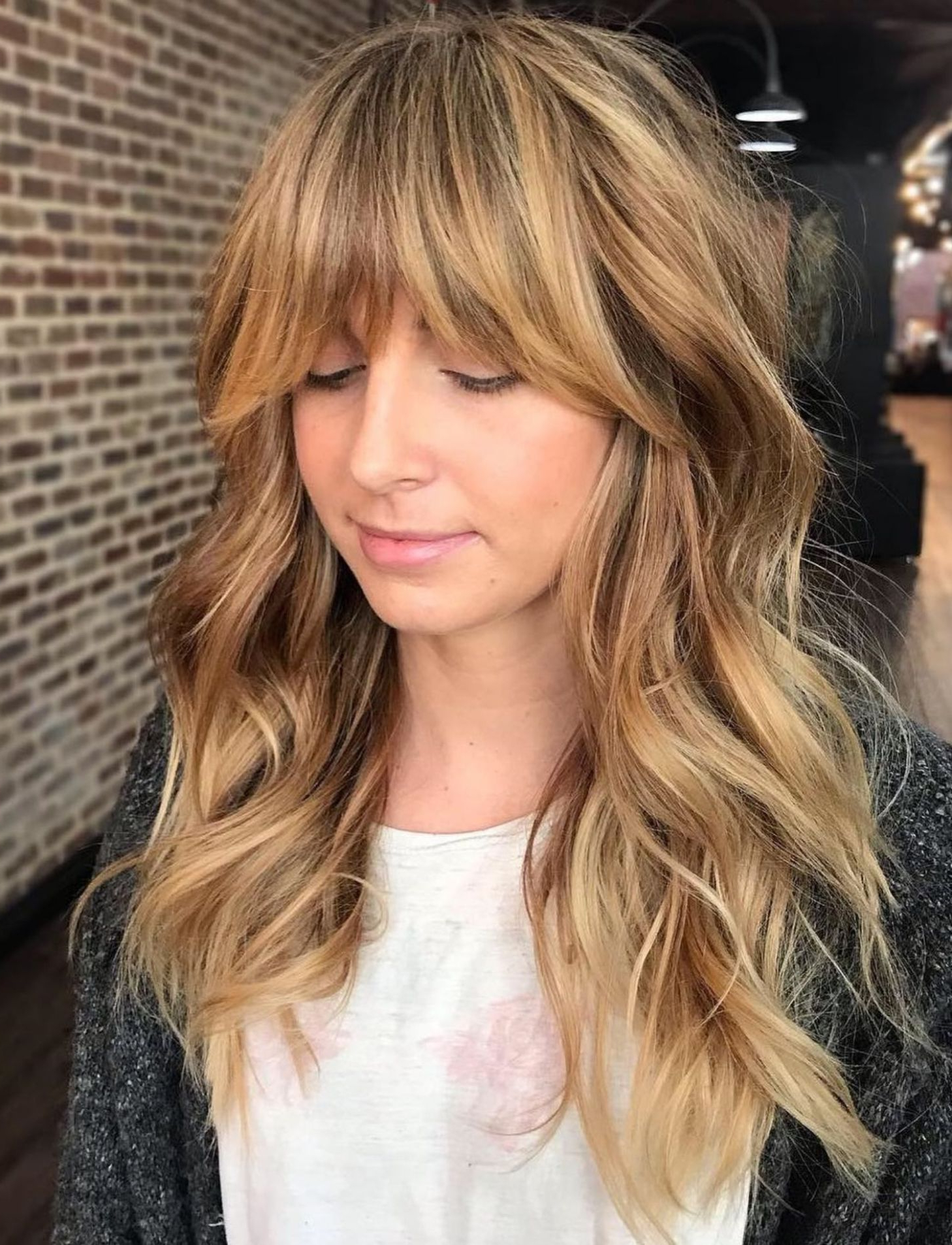 Featured Photo of Honey Bronde Shaggy Hairstyles With Bangs