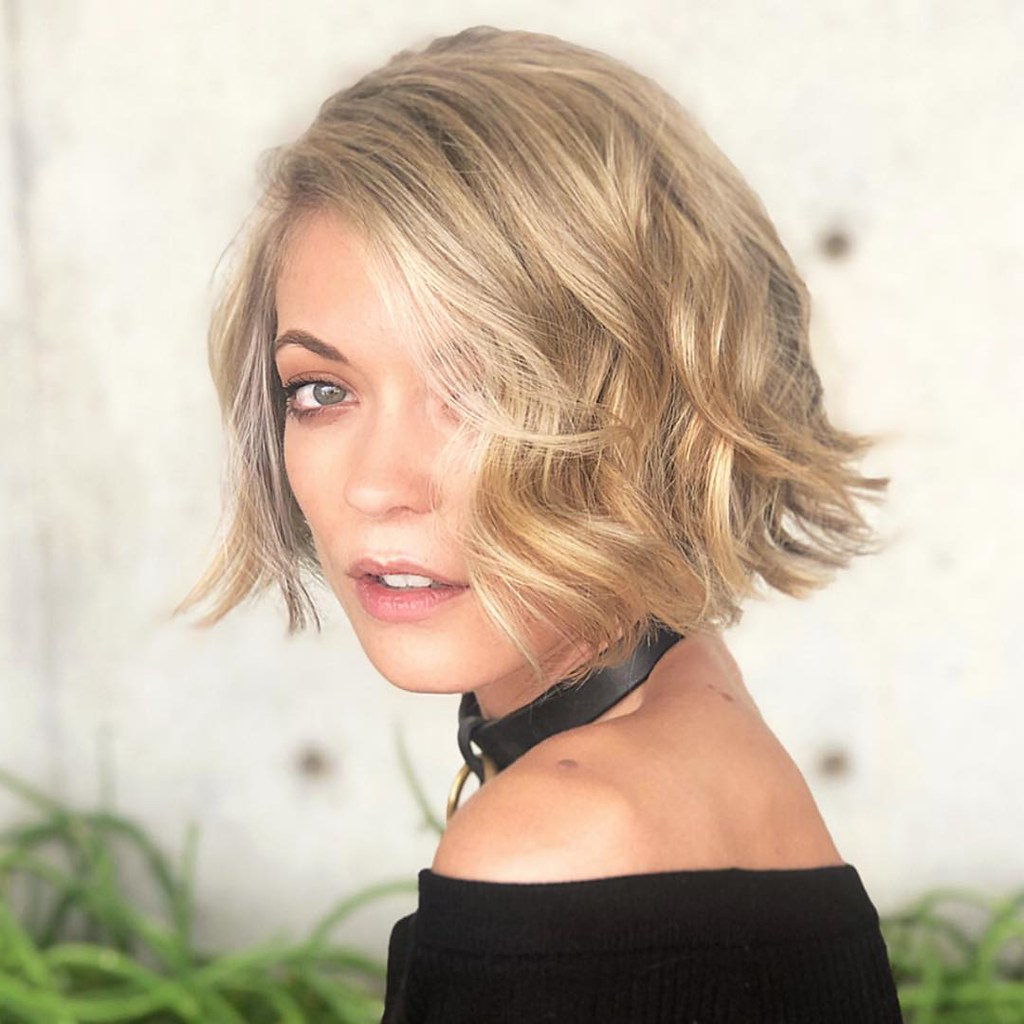 Short Blunt Bob With Side Swept Wavy Texture And Subtle Hi Within Long Curly Pixie Haircuts With Subtle Highlights (View 10 of 20)