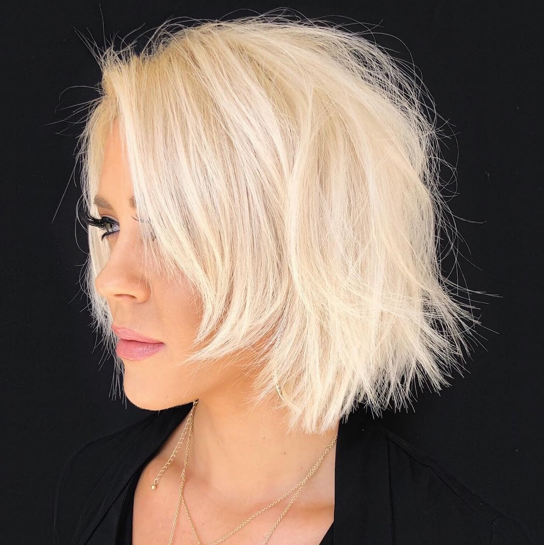Trending Short Layered Haircuts In 2019 Intended For Steeply Angled Razored Asymmetrical Bob Hairstyles (View 16 of 20)
