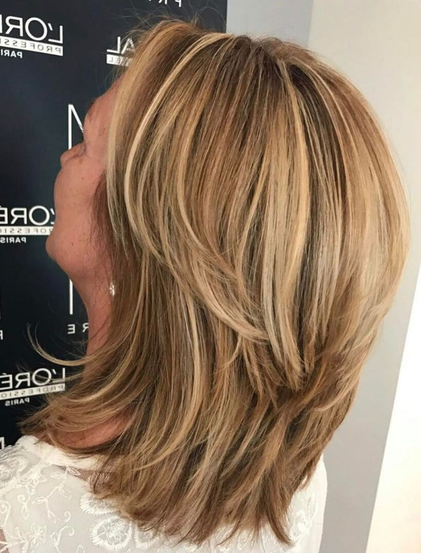 Trendy Mid Length Sliced Bronde Haircuts Pertaining To 50 Modern Haircuts For Women Over 50 With Extra Zing In (View 13 of 20)