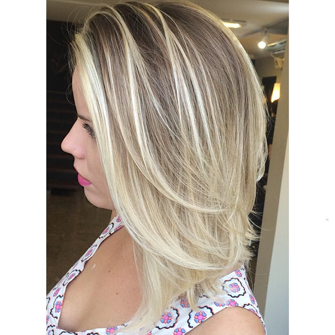 Featured Photo of Mid Length Layered Ash Blonde Hairstyles
