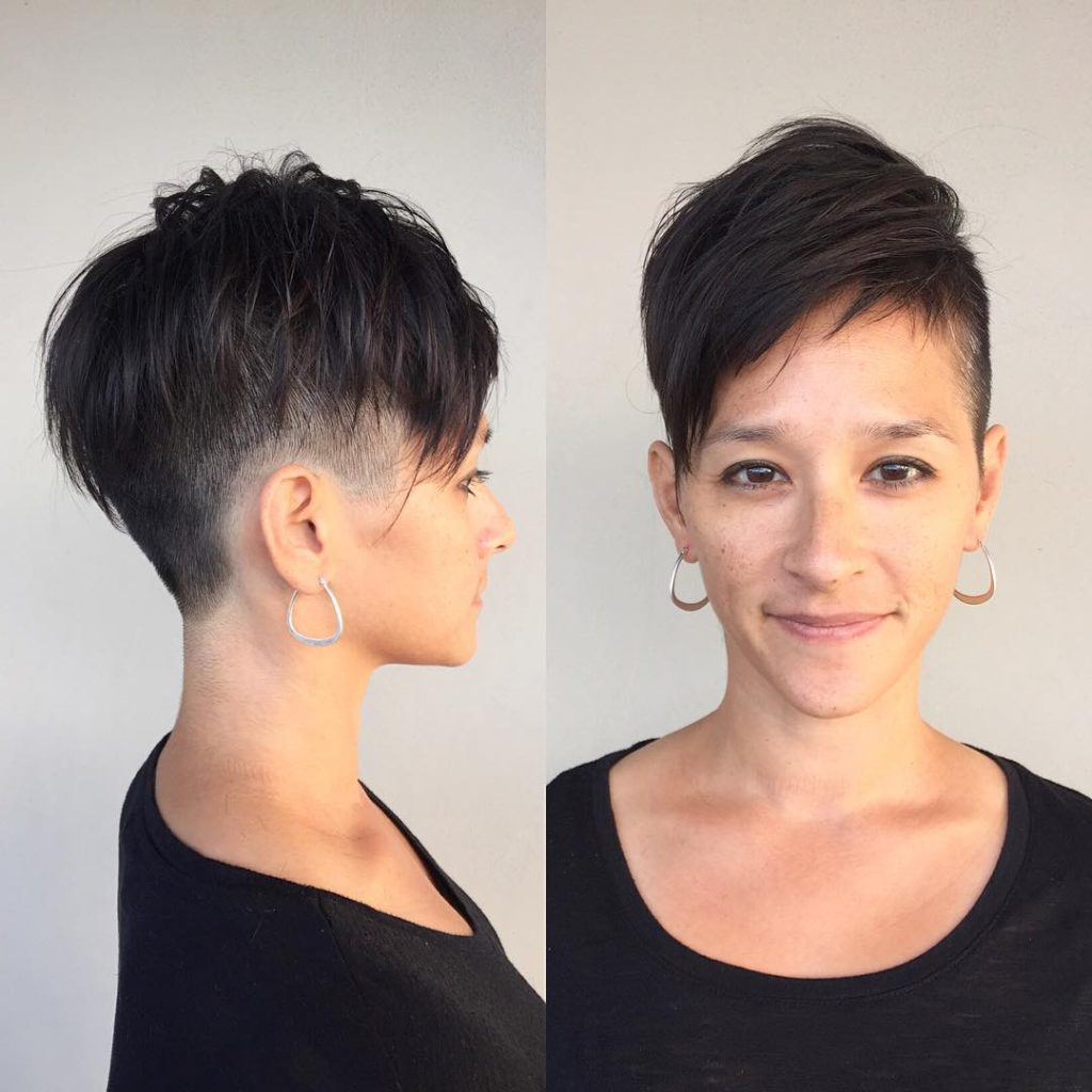 Women's Dark Textured Undercut With Voluminous Undone Fringe In Messy Spiky Pixie Haircuts With Asymmetrical Bangs (View 20 of 20)