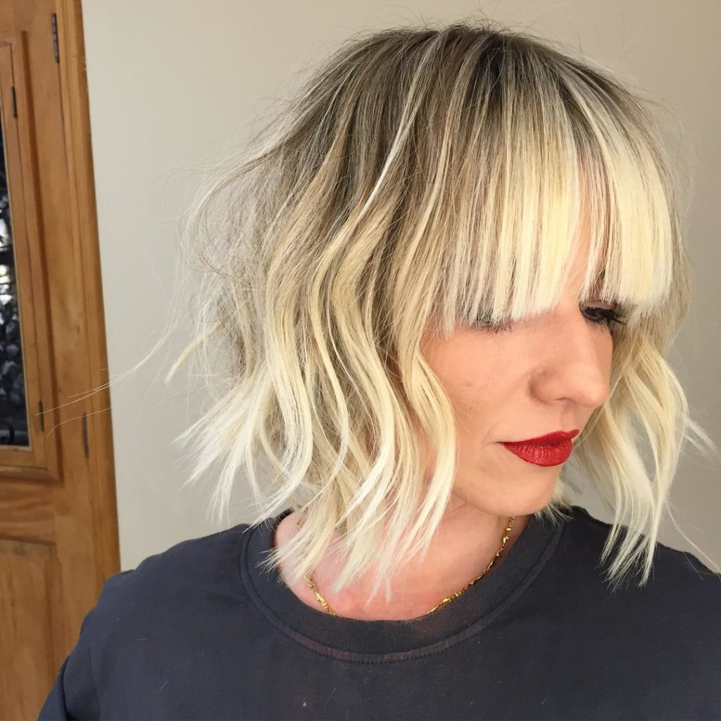 Women's Long Blonde Bob With Choppy Layers And Full Bangs With Regard To Shaggy Blonde Bob Hairstyles With Bangs (View 20 of 20)