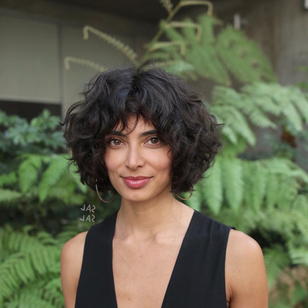 2018 Naturally Curly Bob Hairstyles Within Women's Dark Brunette Layered Bob With Undone Natural Curls (View 17 of 20)