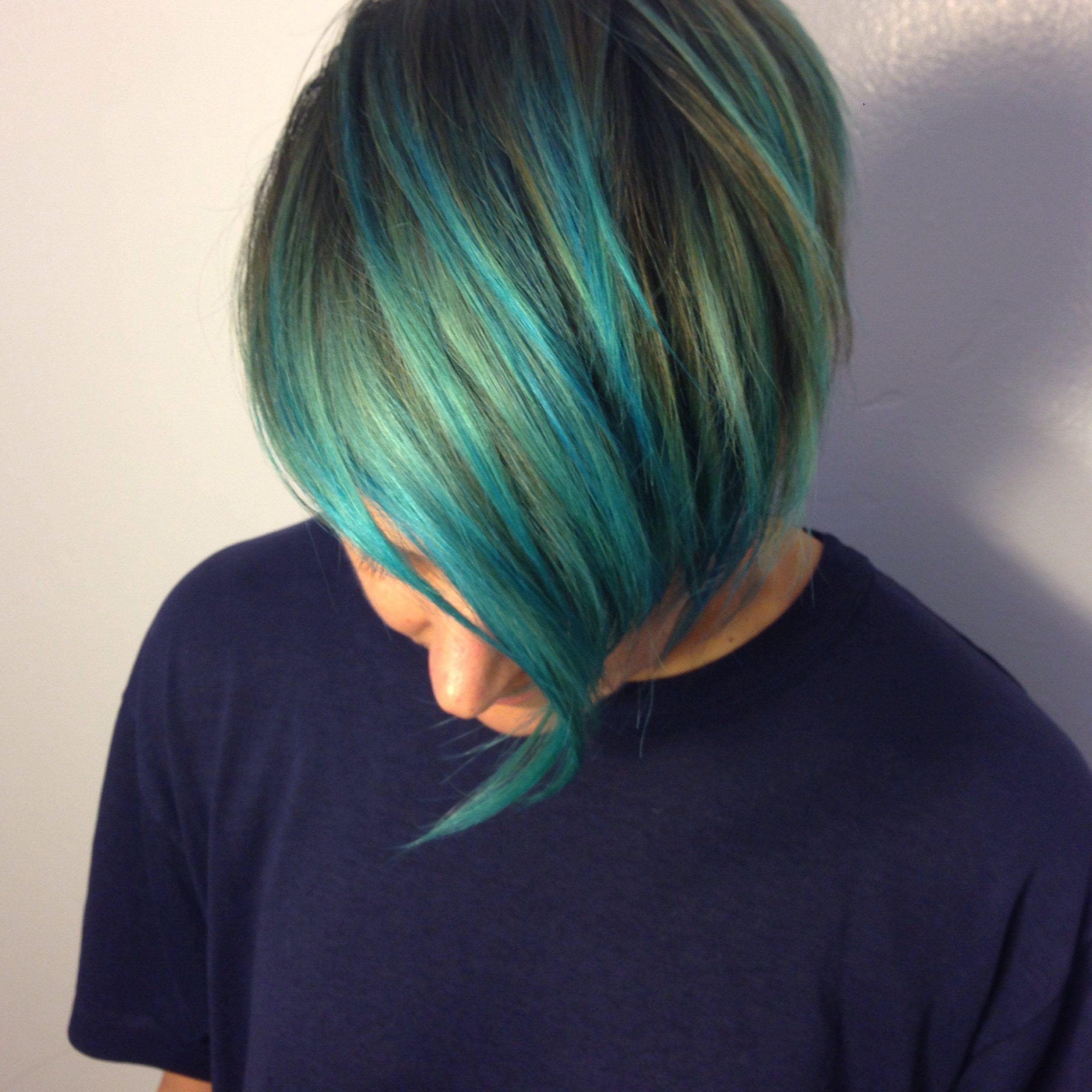 Andrea Lefevre Regarding Fashionable Aqua Green Undercut Hairstyles (View 14 of 20)