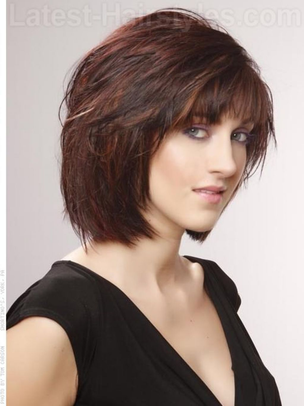 Layered Chin Length Bob With Pertaining To 2018 Bob Hairstyles With Bangs (View 11 of 20)