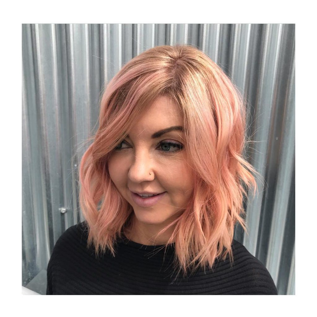 Rose Gold Bob With Long Side Swept Bangs And Messy Beach For Newest Mid Length Beach Waves Hairstyles (View 17 of 20)